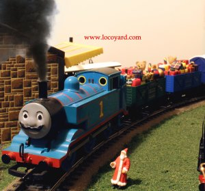 Locoyard 2013 - Thomas the Tank Engine with a mustache for Movember hauls Santas Train