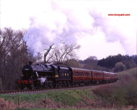Severn Valley Railway -  LMS 2-6-0 2968 at milepost 147-I - 8th April 1995  by Basil Roberts