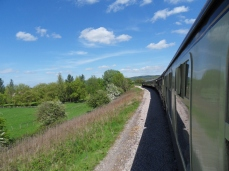 The 12 coach train coming round chicken curve just past Winchcombe