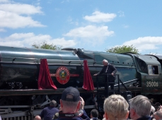 The railway's president Pete Waterman reveals the nameplate renaming the locomotive