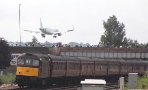 49th Commemoration of The End of Southern Steam 9th July 2016 Railway Touring Company West Coast Eastleigh (27) Flybe - Embraer ERJ-195LR G-FBEG & Class 33 BRCW Type 3 Crompton Bo-Bo D6592 33207 Jim Martin